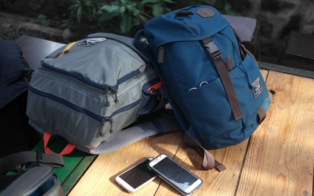Two of the best backpacks for college sitting on a wooden table