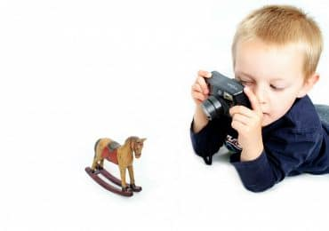 a budding photographer with the best camera for kids