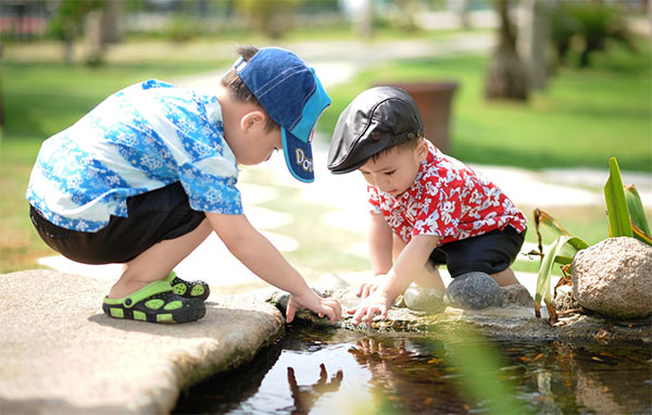 Kids playing at the pond