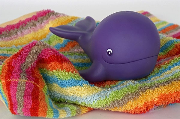 Whale water toy on a towel
