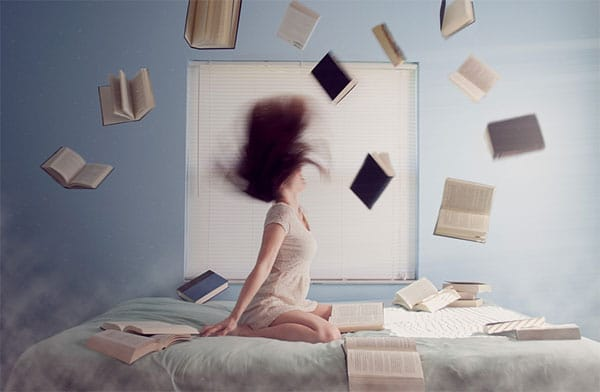 Woman with books flying over her