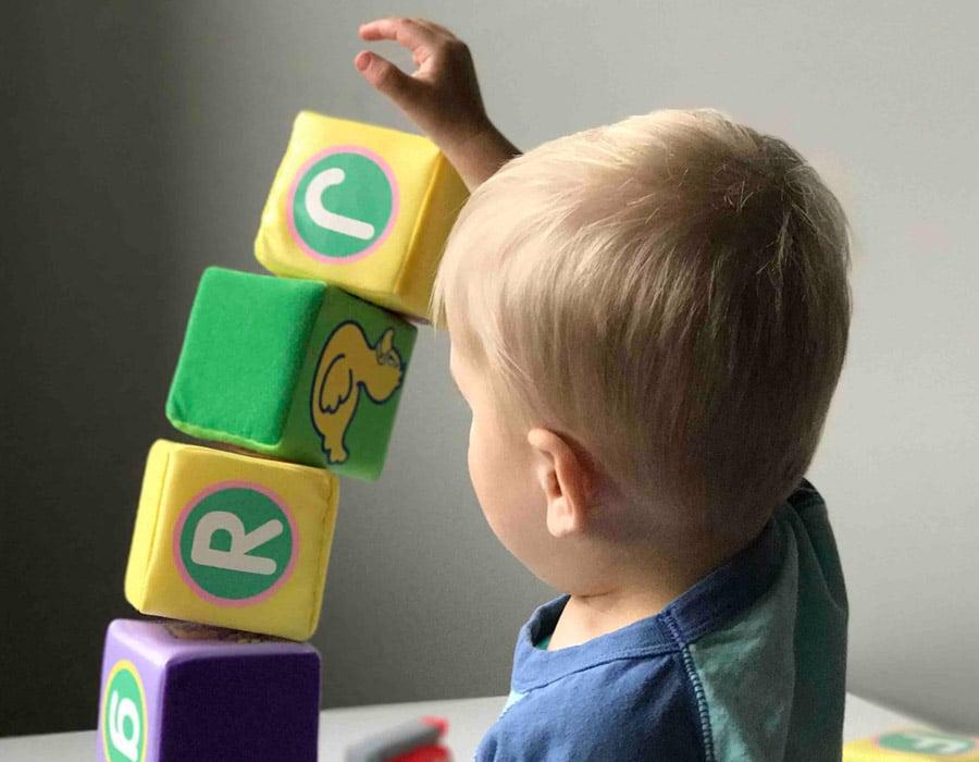 toddler balancing the blocks