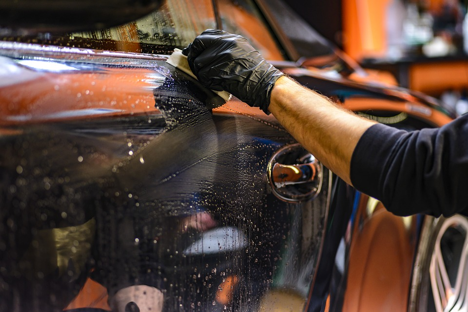 Person polishing a car