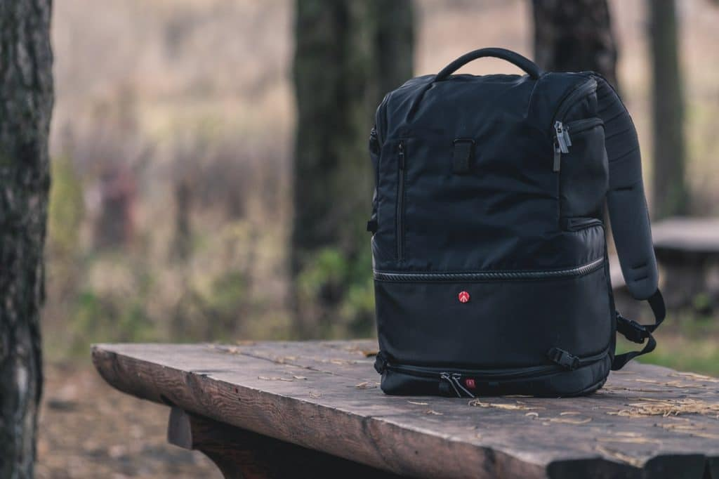 black best waterproof backpack sitting on a bench at an outdoor
