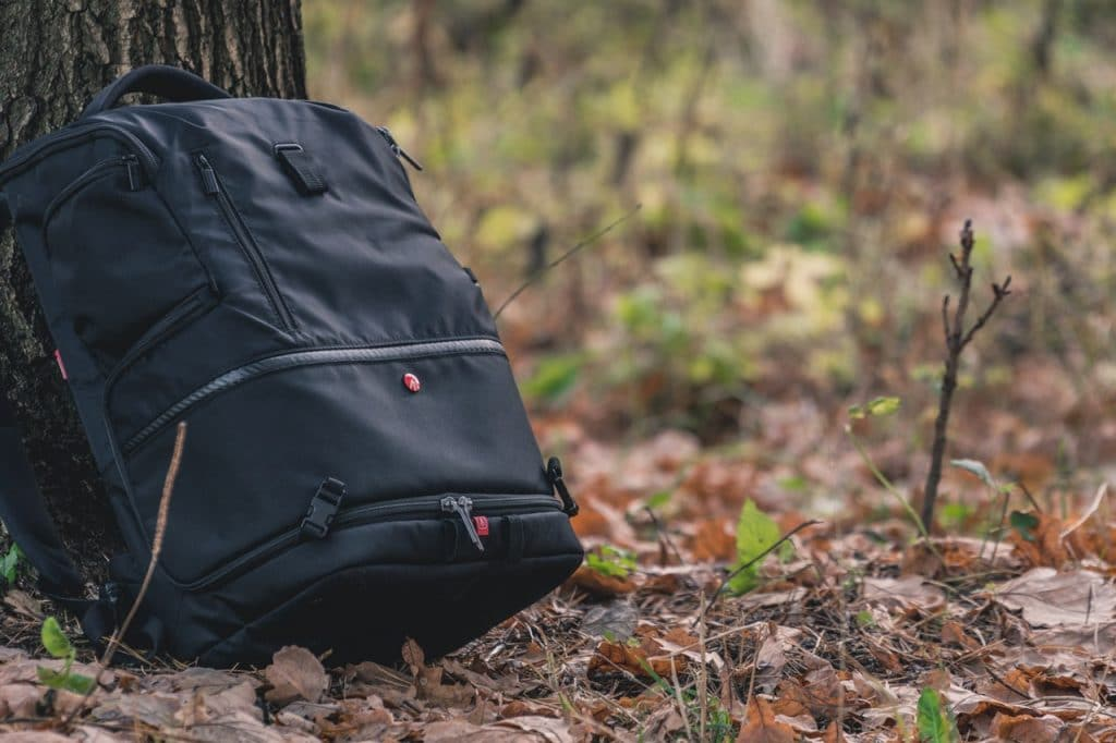 black best waterproof backpack resting on a tree