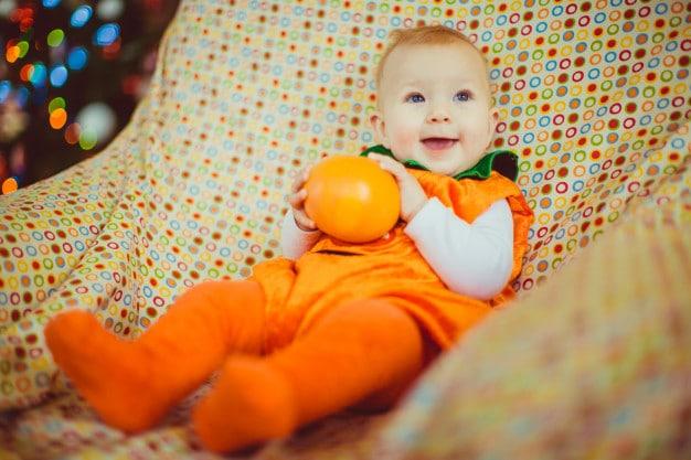 baby in orange suit