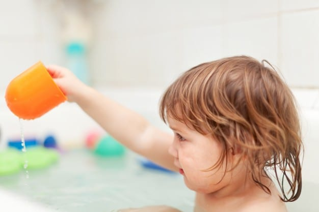 child playing in bathtub