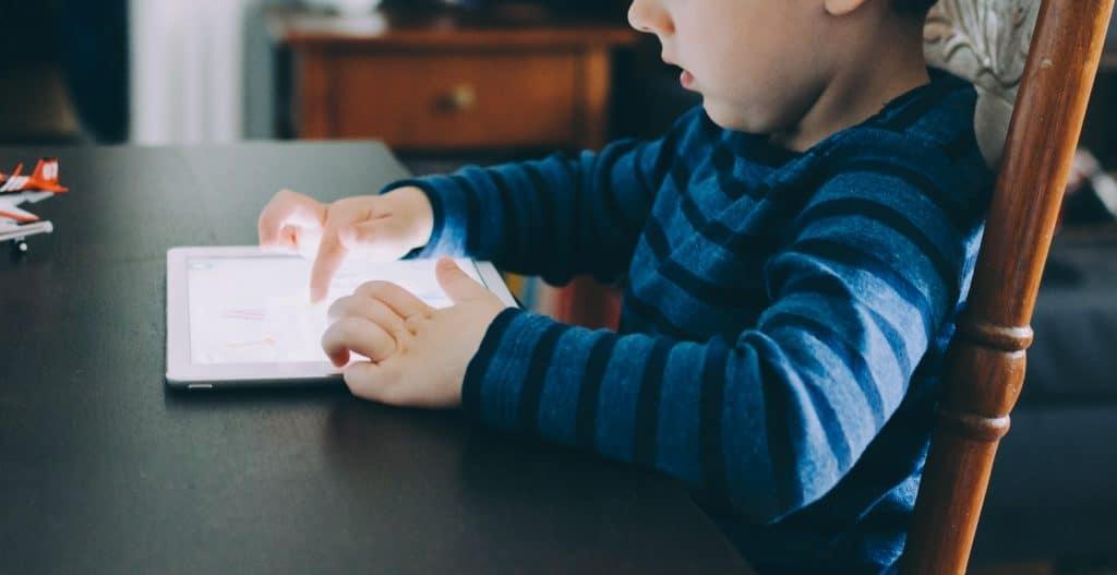 child using digital tablet