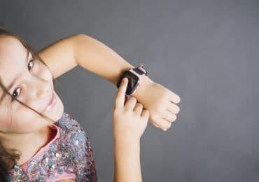 little child using a wristwatch