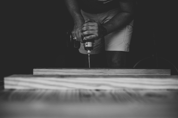 man using cordless screwdriver on wood