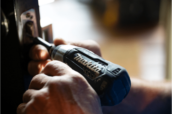 man using makita cordless screwdriver