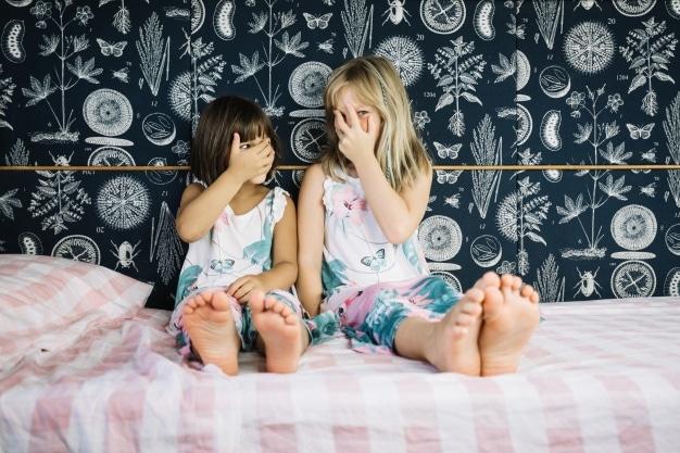 siblings playing hide faces