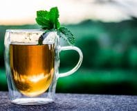 cup of tea with leaf garnishing
