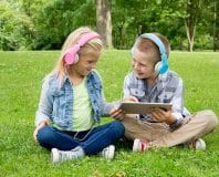 kids using the snug play+ headphones for the best audiobooks for kids