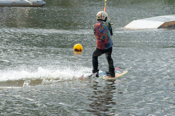 wakeboarder using wakeboard rope